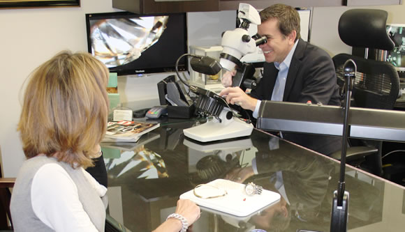 Steve Jarvis Examines a Customer's Jewelry